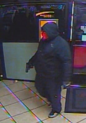 The suspected robber is shown entering a business. (FOX5)