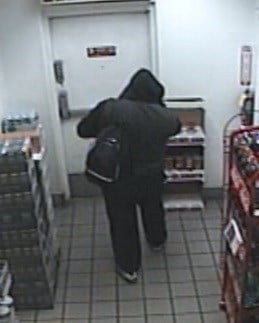 The suspected robber is shown exiting a business. (FOX5)