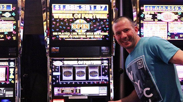 The Cosmopolitan of Las Vegas announced a $1 million progressive jackpot was hit on Feb. 6, 2017. The unnnamed winner is pictured next to the lucky machine. (Source: Twitter/@CosmopolitanLV)