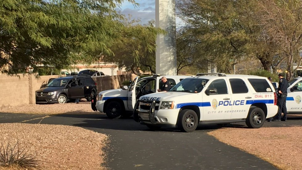 Henderson police surround a neighborhood during a search for an attempted theft suspect on Feb. 7, 2016. (Peter Dawson/FOX5)