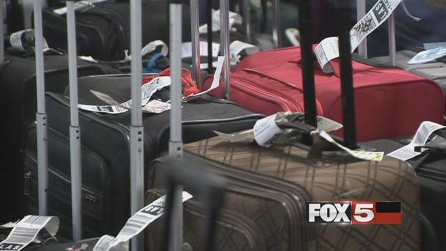 An arrest report stated a group of workers at McCarran Airport were involved in a theft ring involving firearms in checked bags. (FOX5)