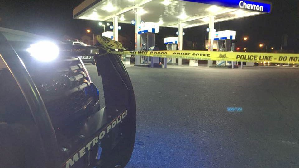 A Metro police vehicle blocks off the gas station during the road rage investigation.