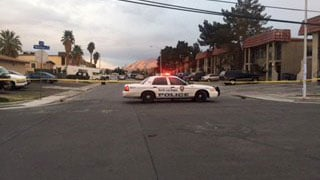 A NLVPD vehicle blocks the scene of a drive-by shooting. (FOX5)