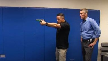 Chris McInnes, the principal firearms instructor for the FBI field office in Las Vegas, goes through the agency's training with FOX5 anchor John Huck. (FOX5)