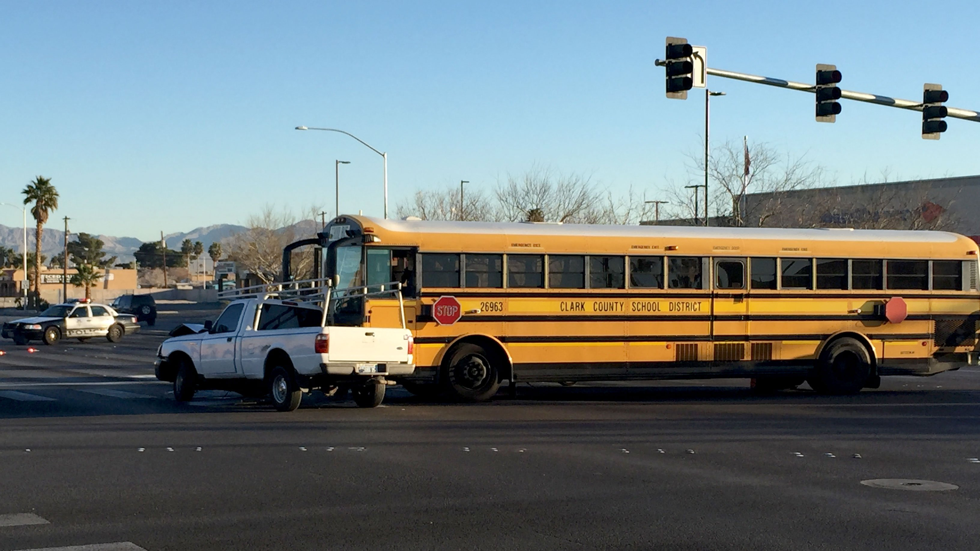 A pickup truck and school bus collided on Martin Luther King Boulevard and Washington Avenue on Feb. 15, 2017. (Luis Marquez/FOX5)
