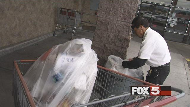Luis Mora retrieves shopping carts and takes out the trash at Cardenas Market in Henderson. He said he supported the protest, but it was important for him to still go to work. (FOX5)