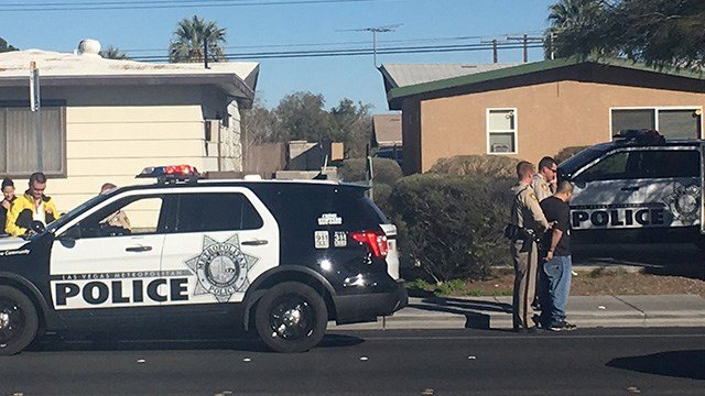 Las Vegas Metro police officers handcuff a person after a reported shooting stemming from a road rage incident in the area of Alta Drive and Jones Boulevard on March 2, 2017. (Miguel Martinez-Valle/FOX5)