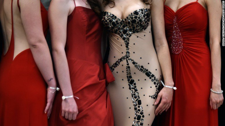 High school graduates pose for a group picture at their prom night. (Getty Images)