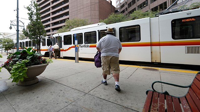 A rider hurries to a waiting light rail train at a stop in front of the 10th U.S. Circuit Court of Appeals on Tuesday, Aug. 23, 2016 in downtown Denver. (AP Photo/David Zalubowski)