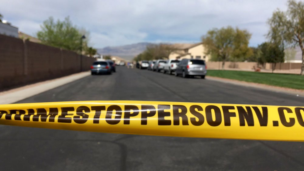 Crime tape blocks a northwest Las Vegas neighborhood after a shooting on March 15, 2017. (Miguel Martinez-Valle/FOX5)