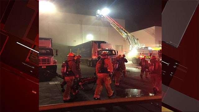 More than 100 workers had to evacuate after a warehouse caught fire.
