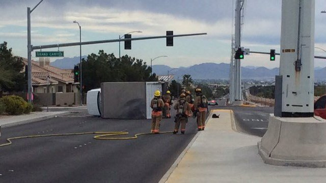 Firefighters responded to an overturned delivery truck near Cheyenne Avenue and Grand Canyon Drive on March 21, 2017. (Source: Las Vegas Fire and Rescue)