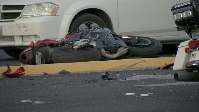 A motorcycle lays on the roadway at Flamingo Road near Eastern Avenue after a deadly crash on March 22, 2017. (FOX5)
