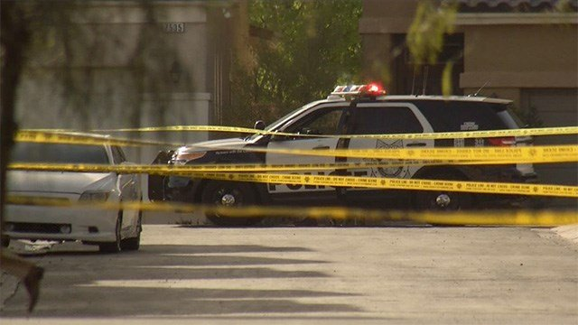 Crime scene tape blocks a neighborhood near Farm Road and Hualapai Way during a deadly shooting investigation on March 17, 2017. (FOX5)
