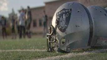 A Raiders' helmet placed on a football field. (Austin Turner/FOX5)