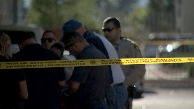 Crime scene investigators comb a scene after a reported homicide near H Street and Owens Avenue on April 1, 2017. (FOX5)