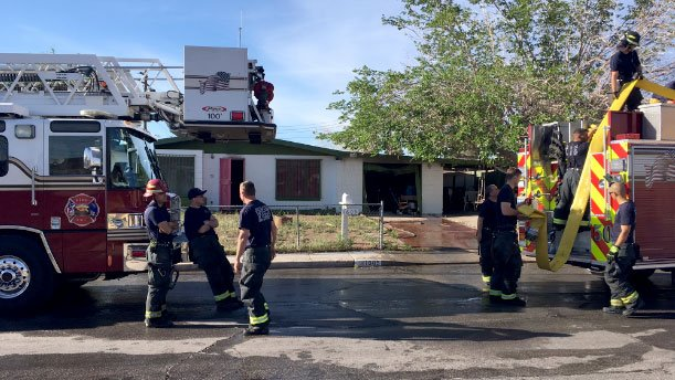 North Las Vegas firefighters at the scene of a house fire on Basswood Avenue on April 4, 2017. (Isaac Torres/FOX5)