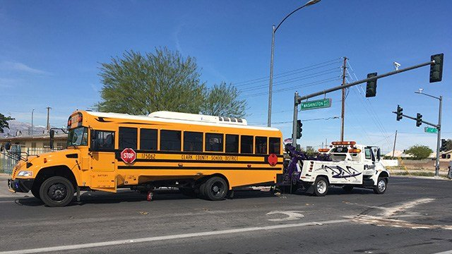 A school bus that was involved in a crash near H Street and Washington Avenue near downtown Las Vegas was towed away on April 5, 2017. (Isaac Torres/FOX5)