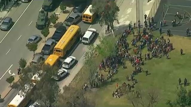 Students of an elementary school in San Bernardino, CA, were evacuated outside after a shooting reported on April 10, 2017. (Source: KABC-TV)