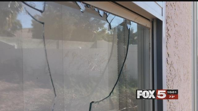 A window was broken during a home invasion in North Las Vegas.