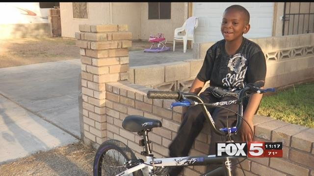 A Metro police officer replaced a boy's stolen bike with a new one.