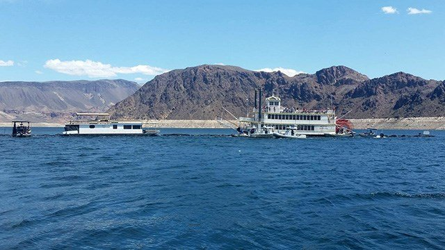 Rescue vessels worked to evacuate passengers off of the Desert Princess at Lake Mead on April 18, 2017. (Source: Richard Keeley)