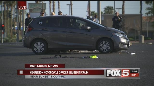 A Henderson police officer was injured in a crash on Green Valley. (FOX5).