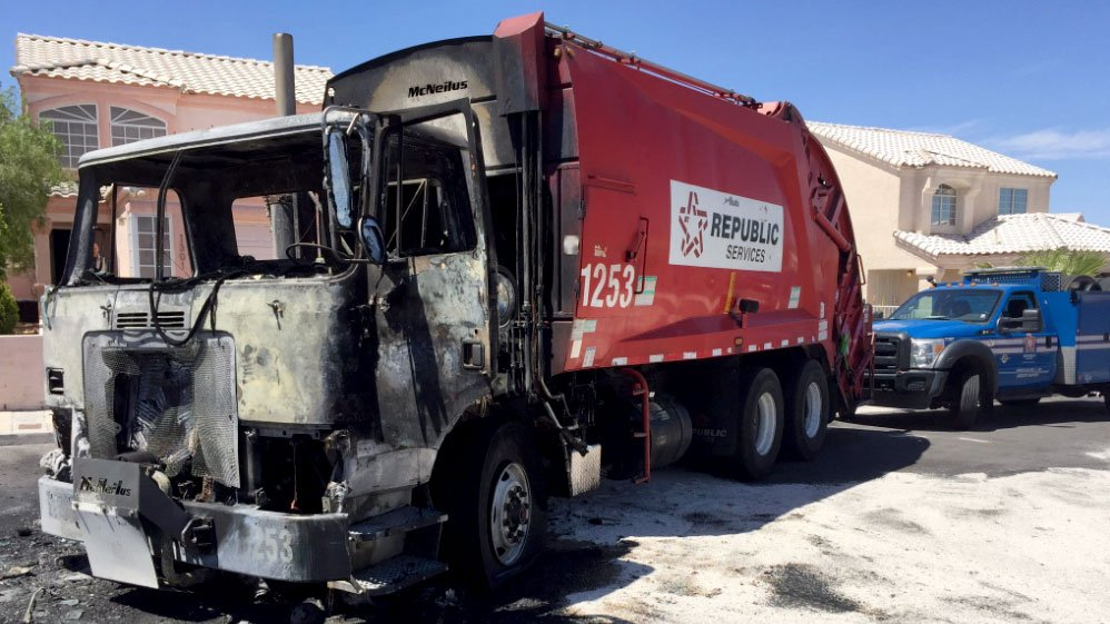 The charred remains of a Republic Services truck after a fire on April 21, 2017. (Adam Herbets/FOX5)
