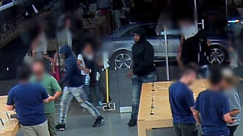 Three suspects are shown in surveillance images. (LVMPD)