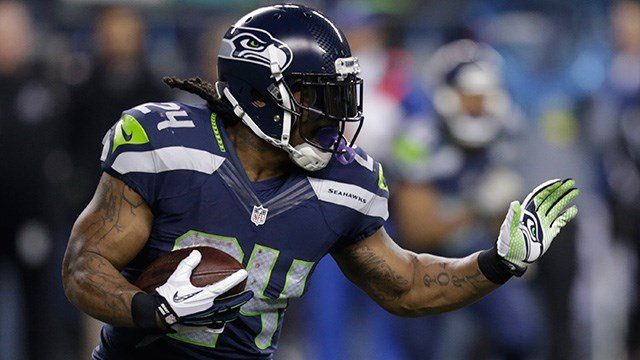 Seattle Seahawks running back Marshawn Lynch rushes against the Arizona Cardinals in the first half of an NFL football game, Sunday, Nov. 15, 2015, in Seattle. (AP Photo/Stephen Brashear)
