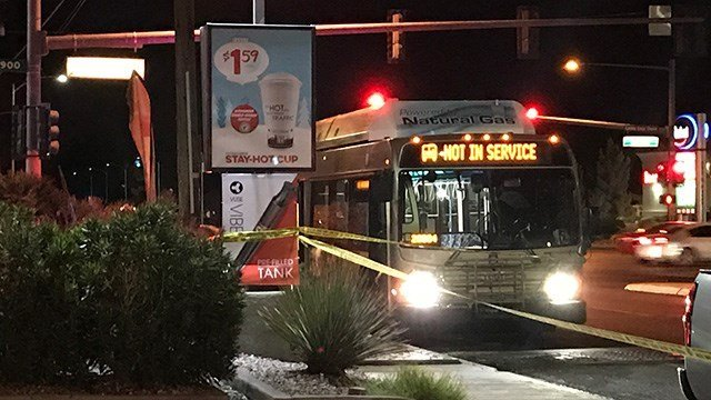 Police tape is put up next to a RTC bus in the area of Washington Avenue and Pecos Road after a deadly shooting on Dec. 15, 2016. (Gai Phanalasy/FOX5)