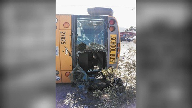 Photo from the scene shows a school bus on its side after a crash on May 4, 2017. (FOX5 source)