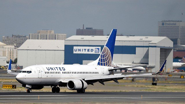 FILE - In this Sept. 8, 2015 file photo, a United Airlines passenger plane lands at Newark Liberty International Airport in Newark, N.J. (AP Photo/Mel Evans, File)