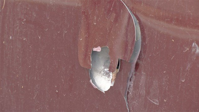 A bullet hole was left following an officer-involved shooting on Shreve Avenue in northeast Las Vegas on May 6, 2017. (FOX5)