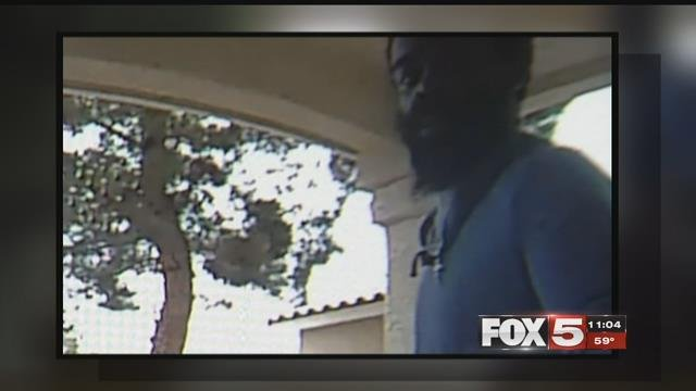 A woman was punched by a robber at her home in Las Vegas.
