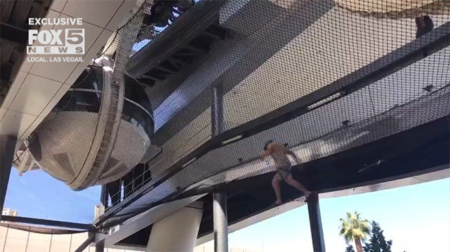 In video submitted to FOX5 on May 12, 2017, a visitor at the High Roller appears to be caught in safety netting beneath the observation wheel. (Source: FOX5 viewer)