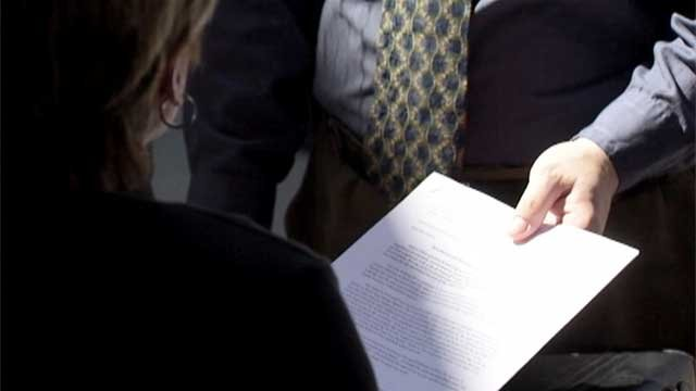An applicant hands over a resume in an undated image. (File)