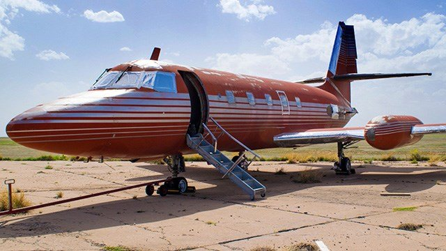 This undated photo provided by GWS Auctions, Inc. shows a private jet once owned by Elvis Presley, on a runway in New Mexico. The plane is set to be auctioned after sitting on a runway in New Mexico for 30 years.  (GWS Auctions, Inc. via AP)