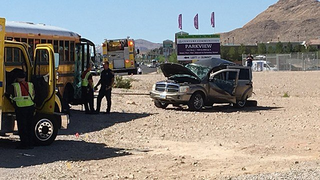 A school bus and a sport-utility vehicle rests in the area of Fort Apache and Post roads after a crash on May 25, 2017. (Jason Westerhaus/FOX5)
