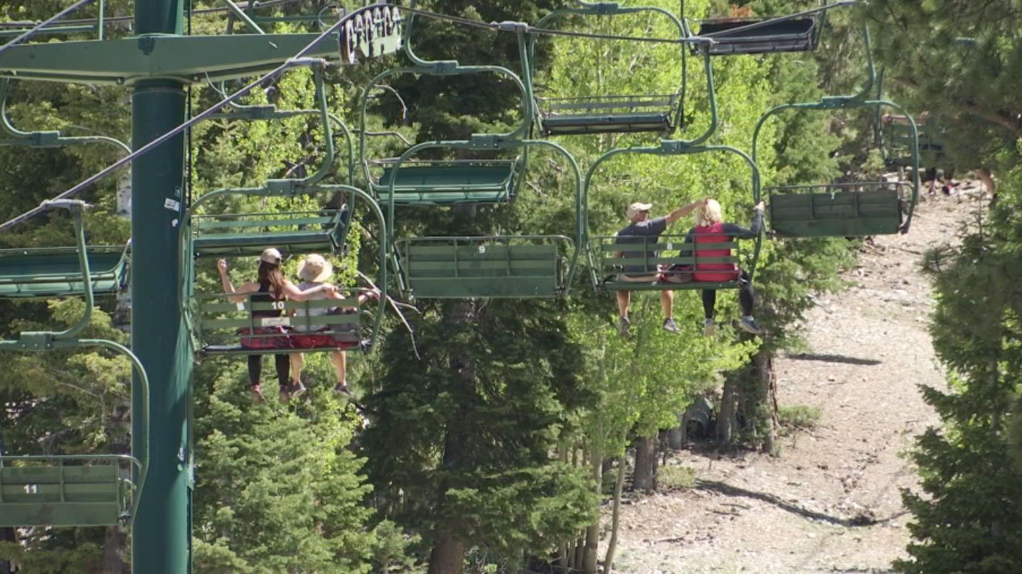 Visitors enjoy the view from the lift at Lee Canyon on May 26, 2017. (Eric Hilt/FOX5)