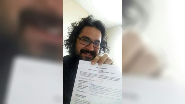 Anthony Garcia, who was fired after pinning an unconscious driver to a wall, holds up his employment application. (Special to FOX5)