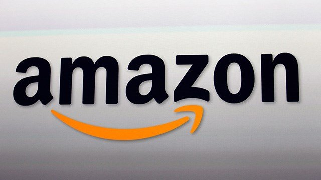FILE - This Sept. 6, 2012, file photo, shows the Amazon logo in Santa Monica, Calif. (AP Photo/Reed Saxon, File)
