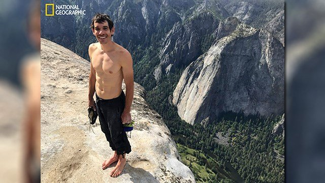 This June 3, 2017, photo shows Alex Honnold atop El Capitan in Yosemite National Park, Calif., after he became the first person to climb alone to the top of the massive granite wall without ropes or safety gear. (Jimmy Chin/National Geographic via AP)