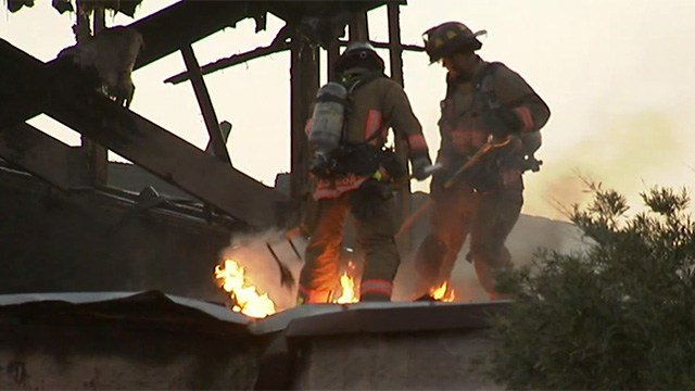 "Firefighters attack ""hot spots"" after much of the flames from a fire destroyed a church on Revere Street in North Las Vegas on June 6, 2017. (Armando Navarro/FOX5)"