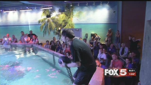 Dixie Dooley performed an underwater escape at SeaQuest Friday. (FOX5)