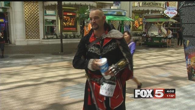 Street performers need to find ways to stay cool in high heat. (FOX5)