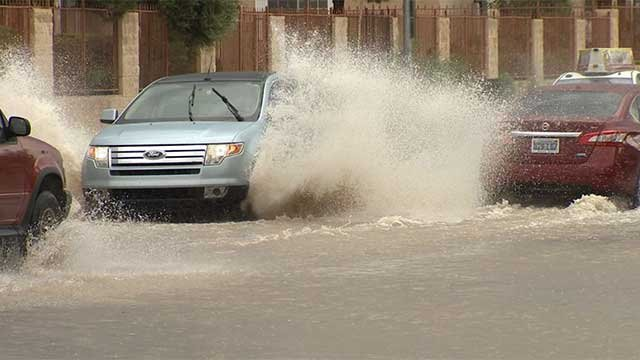 Vehicles drive through a flooded roadway in Las Vegas in an undated image. (FOX5/File)