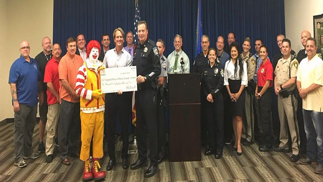 Ronald McDonald presents a $10K check to the Injured Police Officers Fund on Monday July 10, 2017 (LVMPD).