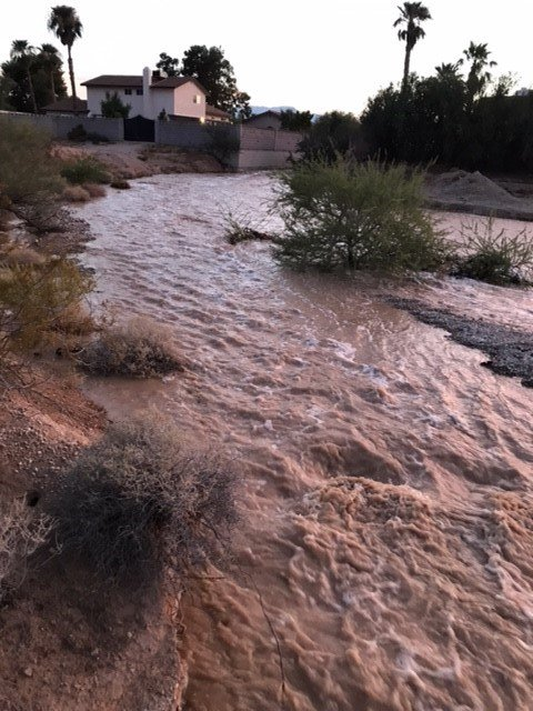 Heavy rains drained into a wash behind a southwest neighborhood. (Photo: DJ Theil)