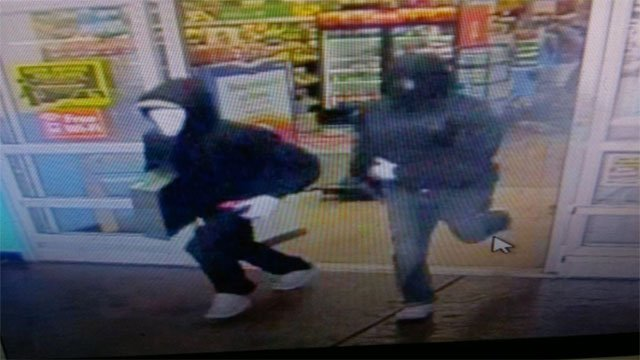 Two robbery suspects are shown fleeing the store (LVMPD).